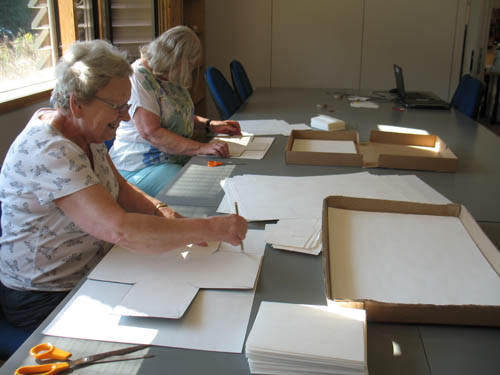 Preparing glassplates for packing at Herefordshire Archives and Record Centre